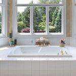Large Bathtub Surrounded by Windows