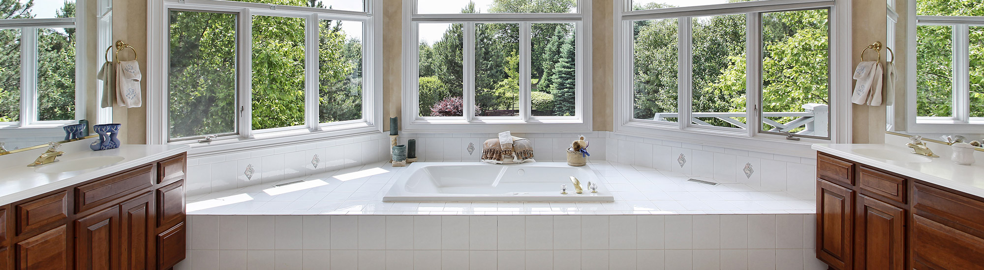 Large Bathtub Surrounded by Windows